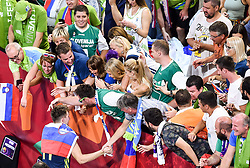 Luka Doncic of Slovenia with supporters of Slovenia celebrate after winning during basketball match between National Teams of Slovenia and Spain at Day 15 in Semifinal of the FIBA EuroBasket 2017 at Sinan Erdem Dome in Istanbul, Turkey on September 14, 2017. Photo by Vid Ponikvar / Sportida