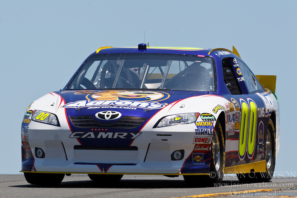 June 24, 2011; Sonoma, CA, USA;  NASCAR Sprint Cup Series driver David Reutimann (00) drives past turn 3 during practice for the Toyota/Save Mart 350 at Infineon Raceway.