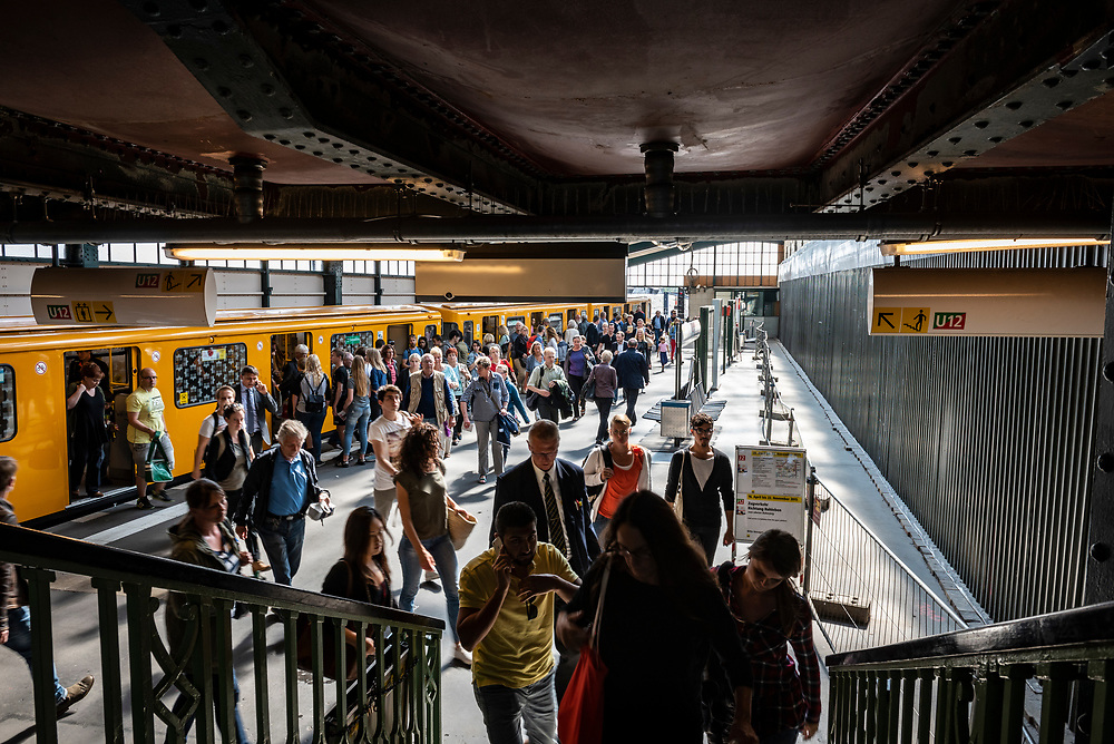 Berlin, Germany - September 4, 2015: Passengers entering and exiting a train at the Gleisdreieck U-Bahn station in Berlin, Germany