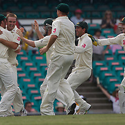 Nathan Hauritz is congratulated after the dismissal of Misbah-ul-Haq during the Australia V Pakistan 2nd Cricket Test match at the Sydney Cricket Ground, Sydney, Australia, 6 January 2010. Photo Tim Clayton