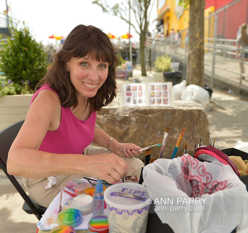 Brooklyn, New York, USA. 10th August 2013. Volunteer artist LAURA YORBURG, of Yorktown Heights, prepares her makeup table, where she will paint designs on visitors during the 3rd Annual Coney Island History Day celebration.