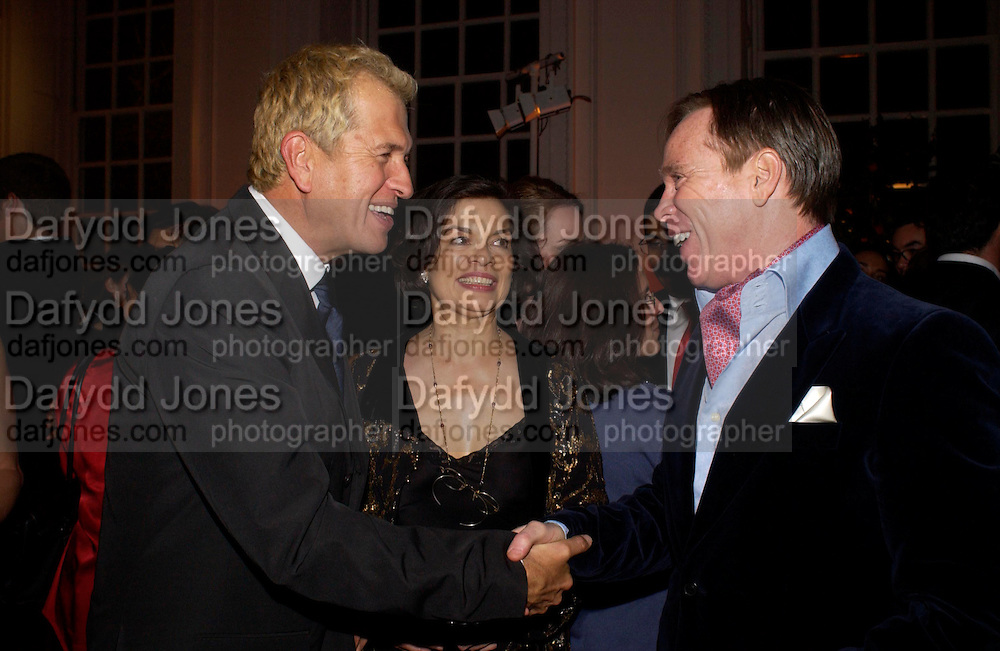 Mario Testino, Bianca Jagger and Tommy Hilfiger. Mario Testino, Bianca Jagger and Kenneth Cole celebrate Women to Women: Positively Speaking. - A publication to raise awareness of women living with Aids. The Orangery, Kensington Palace. 2 December 2004. ONE TIME USE ONLY - DO NOT ARCHIVE  © Copyright Photograph by Dafydd Jones 66 Stockwell Park Rd. London SW9 0DA Tel 020 7733 0108 www.dafjones.com