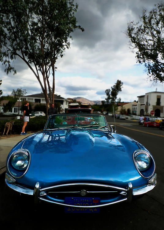 """This convertible Jaguar XKE was parked in Ranch Santa Fe, California.  The title of this image is a play on how the British pronounce the name of the manufacturer, Jaguar.  While Americans say, """"Jag-war"""", the British say, """"Jag-u-ar""""."""
