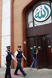 © Licensed to London News Pictures. 23/02/2019. London, UK. Police Officers outside The East London Mosque in Whitechapel, East London as worshipers arrives for Friday prayers. Security has been stepped up around Mosques following Christchurch attack, in New Zealand in which 49 people died following a shooting at two mosques and a man in his late twenties has been charge with murder. Photo credit: Dinendra Haria/LNP