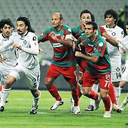Karsiyakaspor's Okan OZTURK (C), Fuat ERARSLAN (2ndR), Volkan OZCAN (R) and Altayspor's Yigitcan ERDOGAN (2ndL) during their Play Off First leg match at Ataturk olympic Stadium in Istanbul Turkey on Monday, 17 May 2010. Photo by TURKPIX