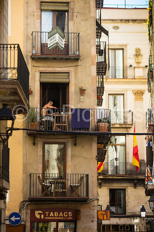 Man having coffee in an appartment in the gothic quarter, Barcelona, Spain.