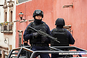 Heavily armed Mexican policemen patrol the historic center during increased security as the city celebrates the 251st birthday of the Mexican Independence hero Ignacio Allende January 21, 2020 in San Miguel de Allende, Guanajuato, Mexico.