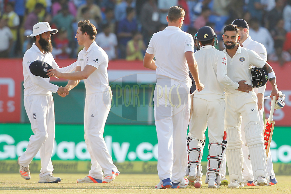Virat Kohli Captain of India with Ravindra Jadeja of India at the end of play on the day 5 of the first test match between India and England held at the Saurashtra Cricket Association Stadium , Rajkot on the 13th November 2016.<br /> <br /> Photo by: Deepak Malik/ BCCI/ SPORTZPICS