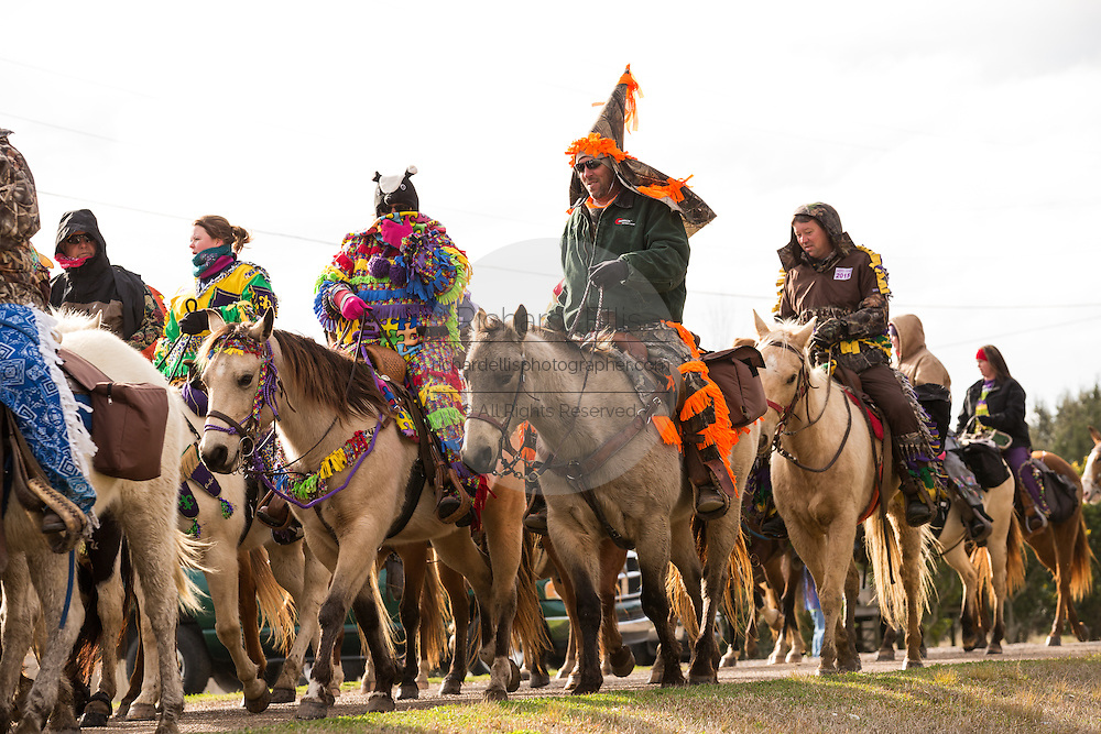Traditional Cajun Mardi Gras costumed revelers on horseback during the Courir de Mardi Gras chicken run on Fat Tuesday February 17, 2015 in Eunice, Louisiana. Cajun Mardi Gras involves costumed revelers competing to catch a live chicken as they move from house to house throughout the rural community.