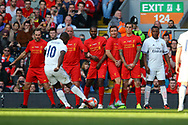 Clarence Seedorf of Real Madrid legends team looks to shoot past the Liverpool wall. Liverpool Legends  v Real Madrid Legends, Charity match for the LFC Foundation at the Anfield stadium in Liverpool, Merseyside on Saturday 25th March 2017.<br /> pic by Chris Stading, Andrew Orchard sports photography.