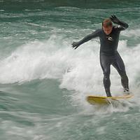 Paul Barrett (MR) river wave surfing on Kananaskis River, Kananskis Provincial Park, near Banff and Calgary, Alberta, Canada