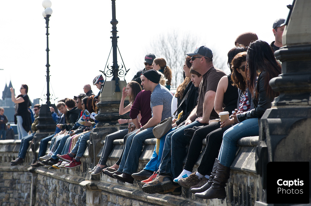 People look over the crowd attending 4/20 on Parliament Hill. April 20, 2014.
