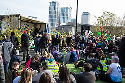 London, UK. 15th April 2019. Climate campaigners from Extinction Rebellion block Waterloo bridge to create a Garden Site during the first day of 'International Rebellion UK - Shut Down London!' events to call on the Government to take urgent action to address climate change.