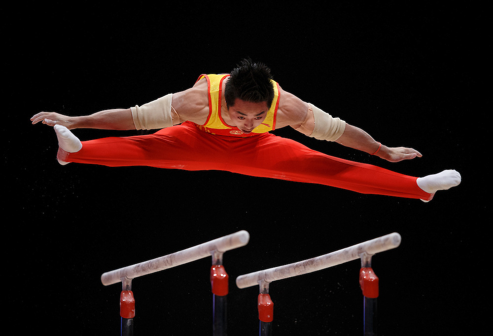 Hao You of China performs on the Parallel Bars at the 46th FIG Artistic Gymnastics World Championships Apparatus Final in Glasgow, Britain, 1 November 2015.