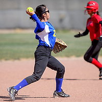 032615       Cable Hoover<br /> <br /> Zuni Thunderbird shortstop Cassie Niiha (1) throws a St. Michael Cardinal runner out at first Thursday at Tohatchi High School.