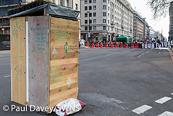 A portal made from reclaimed timber rests on Oxford Street as hundreds of environmental protesters from Extinction Rebellion occupy Marble Arch, camping in the square and even on the streets, blocking access to traffic on Park Lane and Oxford Street in London's usually traffic-heavy west end. . London, April 16 2019.