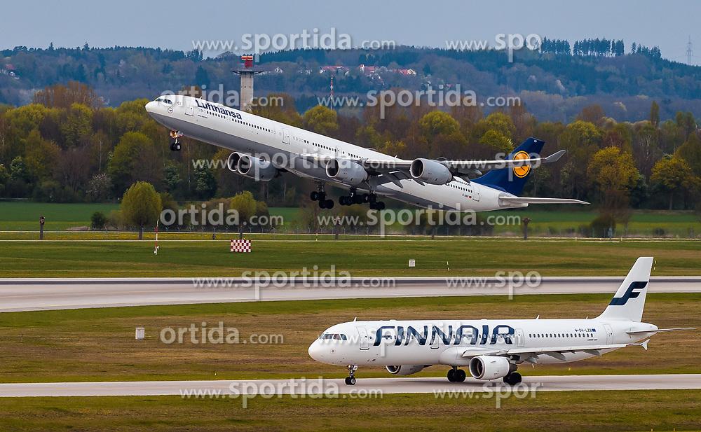 THEMENBILD - in Airbus A340-642 Flugzeug der deutschen Fluglinie Lufthansa mit der Kennung D-AIHV und ein Airbus A321 der finnischen Fluglinie Finnair mit der Kennung OH-LZB am Rollfeld, aufgenommen am 13. April 2017, Flughafen München, Deutschland // an Airbus A340-642 aircraft of the German Airline Lufthansa with the registration number D-AIHV and a Airbus A321 of the Finnish Airline Finnair with the registration number OH LZB on the Airstrip at the Munich Airport, Germany on 2017/04/13. EXPA Pictures © 2017, PhotoCredit: EXPA/ JFK