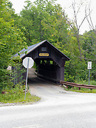 View of Gold Brook Covered Bridge on an overcast day, near Stowe, Vermont, USA.