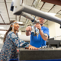 Scott Halliday, right, shows Masha Kovner, left, of the Yakuts tribe, how the Navajo Technical University industrial engineering program develops 3D scans of objects they plan to replicate. The Yakuts delegates visited the facilities in Crownpoint on Monday.
