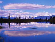 Mountains of the Alaska Range and Pothole Lake cloud reflections in water, Denali Highway, Alaska
