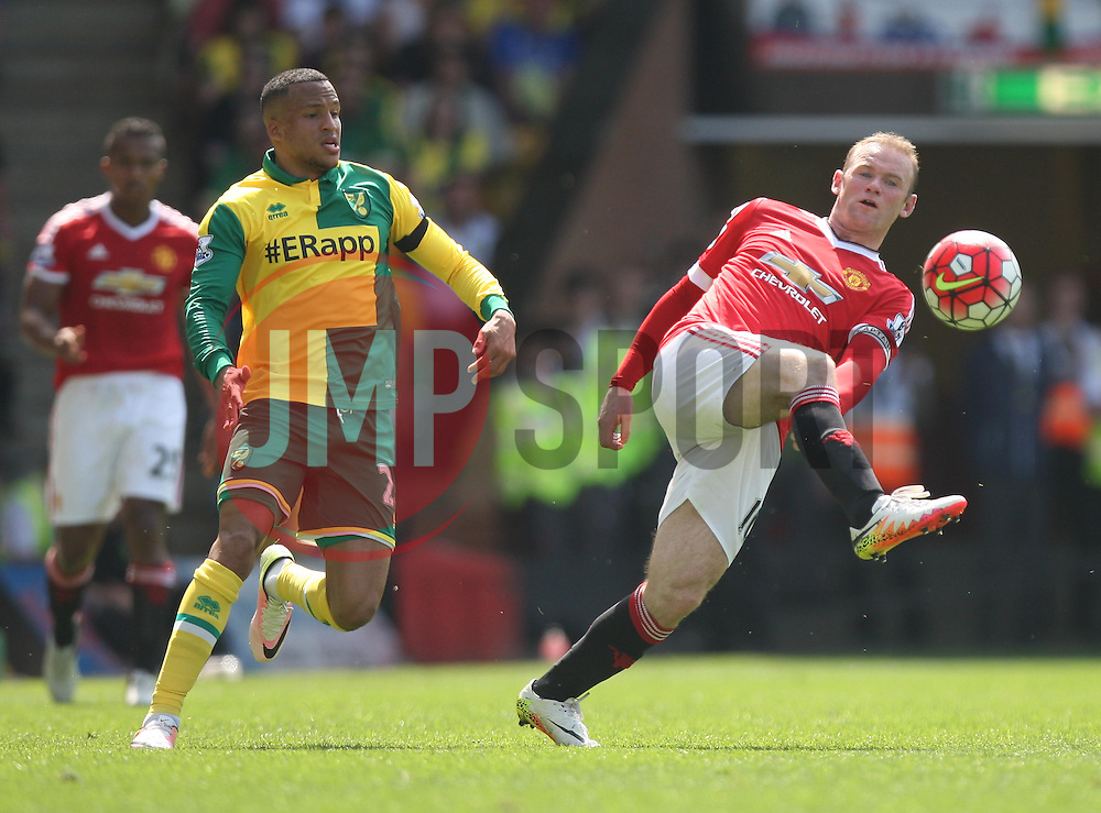 Martin Olsson of Norwich City (L) and Wayne Rooney of Manchester United in action - Mandatory by-line: Jack Phillips/JMP - 07/05/2016 - FOOTBALL - Carrow Road - Norwich, England - Norwich City v Manchester United - Barclays Premier League