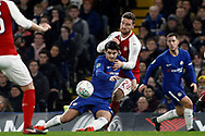 Alvaro Morata of Chelsea (L) is fouled by Shkodran Mustafi of Arsenal (R). Carabao Cup , semi final 1st leg match, Chelsea v Arsenal at Stamford Bridge in London on Wednesday 10th January 2018.<br /> pic by Steffan Bowen, Andrew Orchard sports photography.