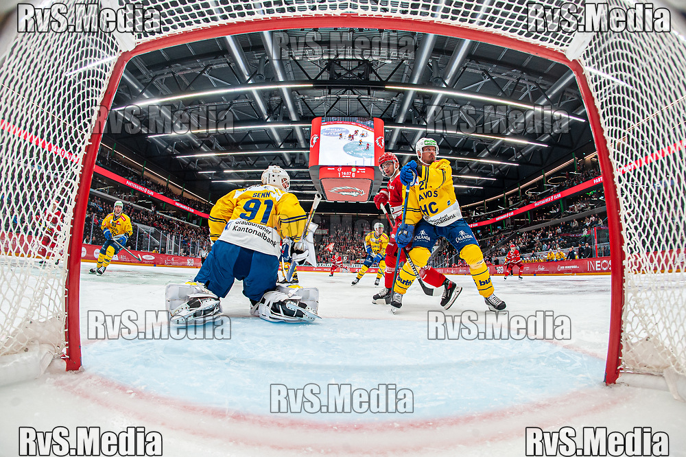 LAUSANNE, SWITZERLAND - SEPTEMBER 24: Tim Bozon #94 of Lausanne HC tries to score against Goalie Gilles Senn #91 of HC Davos during the Swiss National League game between Lausanne HC and HC Davos at Vaudoise Arena on September 24, 2021 in Lausanne, Switzerland. (Photo by Robert Hradil/RvS.Media)
