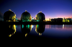 Spherical tanks lit at night at a petrochemical plant in Houston, Texas.