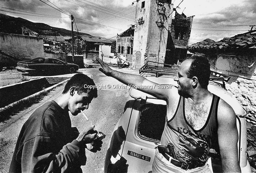 Kosovo. Pec. This Albanian came back from the United States to fight in Kosovo. After several years of prison at the beginning of the 80s, he had chooses the exile. Today, he is back in his city destroyed and cannot nor wants to imagine a cohabitation with the Serbian.