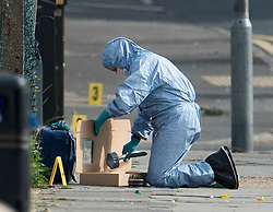 © Licensed to London News Pictures. 24/06/2018. London, UK. A police forensics officer places a crutch in an evidence box at the scene where a 15 year old boy was stabbed to death at North Romford Community on Saturday night. Three teenagers have been arrested in connection with the death. Photo credit: Ben Cawthra/LNP