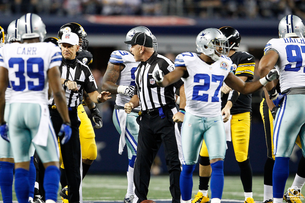 Head linesman John McGrath (5) expresses some anger after being knocked over after a play by Dallas Cowboys and Pittsburgh Steelers players at Cowboys Stadium in Arlington, Texas, on December 16, 2012.  (Stan Olszewski/The Dallas Morning News)