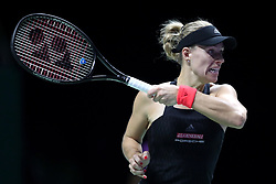 October 26, 2018 - Singapore - Angelique Kerber of Germany returns a shot during the match between Angelique Kerber and Sloane Stephens on day 6 of the WTA Finals at the Singapore Indoor Stadium. (Credit Image: © Paul Miller/ZUMA Wire)