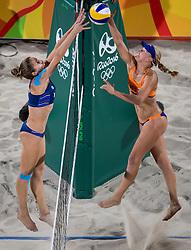 06-08-2016 BRA: Olympic Games day 1, Rio de Janeiro<br /> Madelein Meppelink #2 en Marleen van Iersel #1 hebben de eerste test op de Copacabana goed doorstaan. De Nederlandse beachvolleybalsters wonnen hun poulewedstrijd tegen het koppel Perez Pazo/Agudo Gonzalez zonder problemen: 21-17, 21-11.
