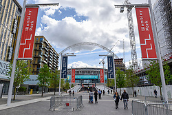 © Licensed to London News Pictures. 26/04/2018. LONDON, UK.  A general view of the exterior of Wembley Stadium and its world famous arch.  It is reported that the Football Association (FA) has received a bid of GBP800m from Shahid Khan, owner of Fulham FC and the Jacksonville Jaguars NFL franchise, to purchase the stadium.  If the bid is successful, the FA will retain its organisational base at the stadium, but will open the way for the creation of the first NFL franchise located out of the United States.  Photo credit: Stephen Chung/LNP