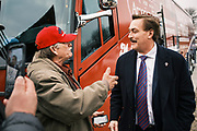 """06 DECEMBER 2020 - DES MOINES, IOWA: MIKE LINDELL, right, founder of My Pillow and supporter of President Donald Trump, talks to people at a rally against the outcome of the US election. Lindell is frequent Trump surrogate and is considering a run for the Governor of Minnesota. About 1,000 supporters of outgoing US President Donald Trump rallied in Des Moines Sunday to show their support for the President and to protest the outcome of the US Presidential election. They started with a rally in the suburbs of Des Moines then drove in a motorcade through the city, ending at the State Capitol. They repeated many of Trump's discredited claims that the election was marked by fraud and that Trump actually won. The protest was a part of the national """"March for Trump"""" effort, culminating in a march in Washington DC on December 13. Joe Biden won the election, with 306 electoral votes to Trump's 232.      PHOTO BY JACK KURTZ"""