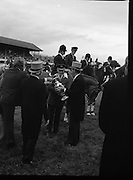 Aga Khan Trophy..1979..10.08.1979..08.10.1979..10th August 1979..The annual staging of the Aga Khan Cup took place  at the Royal Dublin Showgrounds, Ballsbridge,Dublin today.It was the first time since 1937 that Ireland won the trophy outright. The winning Irish team comprised of Paul Darragh,Capt Con Power,James Kernan and Eddie Macken..President, Dr Patrick Hillery, is pictured presenting Col Ringrose with the Aga Khan Cup after the Irish team's great achievement in winning the cup outright for the first time since 1937.