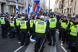 London, UK. 10th June, 2018. Police officers move on pro-Israel activists proteting against the pro-Palestinian Al Quds Day march through central London organised by the Islamic Human Rights Commission. An international event, it began in Iran in 1979. Quds is the Arabic name for Jerusalem.