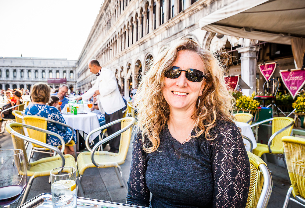 Portrait of a middle aged woman at an outdoor cafe in Sait Marks Square, Venice, Italy.