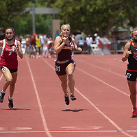 Rehoboth Lynx Meg Zwiers, center, competes in the 100 meter dash at the NMAA 2A track and field state finals in Albuquerque Friday.