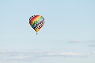 Middletown, New York - A hot air flies through the sky after taking off from  Randall Airport on  April 12, 2014.