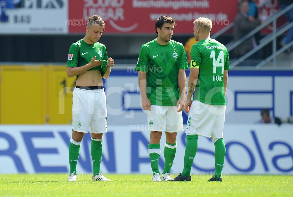 FUSSBALL   1. BUNDESLIGA   SAISON 2012/2013   TESTSPIEL  SC Paderborn - Werder Bremen        29.07.2012 Tom Trybull, Sokratis Papastathopoulos und Aaron Hunt (v.l., alle SV Werder Bremen)