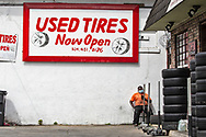 New Orleans,  April 4, 2020, Man wearing a mask outside of a used tire shop, as the Coronavirus continues to spread globaly.