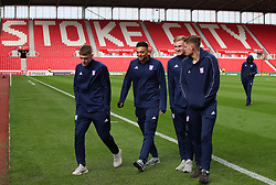 Ipswich Town players on the pitch at the Bet365 Stadium ahead of the Sky Bet Championship match between Stoke City' and Ipswich Town