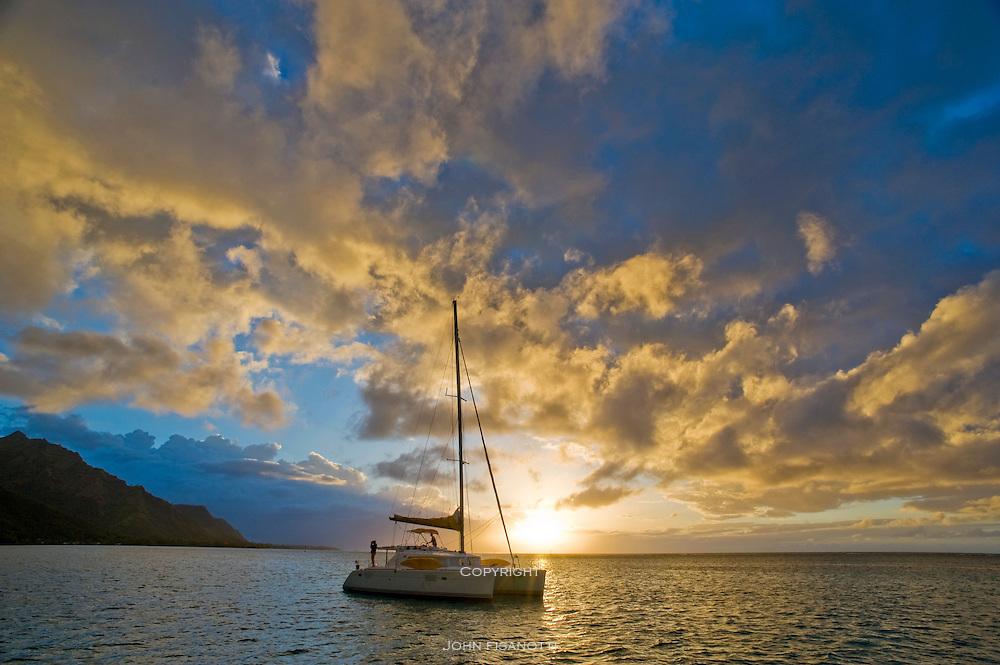 Sunset with Catamaran in foreground, at Opunohu Bay, Moorea