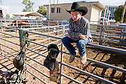 02 NOVEMBER, 2008 -- PHOENIX, AZ:  A boy watches the action from behind the chutes at the Arizona High School Rodeo at the Arizona State Fair in Phoenix. Teams from across the state participate. The Arizona High School Rodeo Association sponsors a full season of high school rodeo that culminate in a championship rodeo in June.  PHOTO BY JACK KURTZ