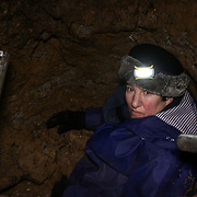 Tree protector Maria in the tunnel dug by activists in Highbury Corner on the 8th of February 2021, London, United Kingdom. Activist say they have dug a tunnel at Highbury Corner Tree Protection Camp ahead of eviction to keep bailliffs from evicting the camp. Maria shows the beginning of the tunnel.