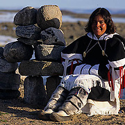"Northwest Territories, known as Nunuvat, Canada. Paula Hughson in traditional ""Amautiq"" near Sila river, Wager Bay."