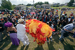 29 August 2015. Lower 9th Ward, New Orleans, Louisiana.<br /> Hurricane Katrina 10th anniversary memorial.<br /> A crowd gathers at the levee wall for a memorial to remember hurricane Katrina. <br /> Photo credit©; Charlie Varley/varleypix.com.