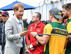 Prince Harry Duke of Sussex meets athletes at  the Invictus Games and joined a medal presentation. He was presented with a pair of Budgie Smuggler swimming trunks by the Australian athletes. The Duchess of Sussex who was due to be there pulled out of the event due to be tired and needing rest ahead of the rest of the Royal Tour, the Botanic Gardens, Sydney. Photo credit should read: Doug Peters/EMPICS