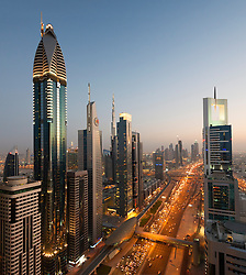 Evening dusk view of skyline of Dubai along Sheikh Zayed Road in United Arab Emirates